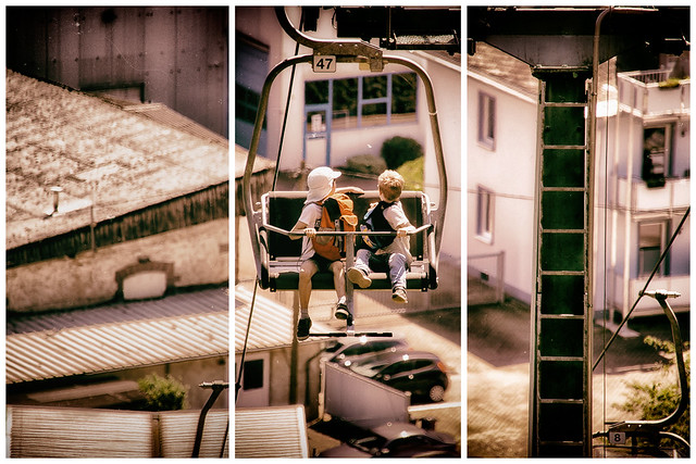 Children in a seat cable car - triptych