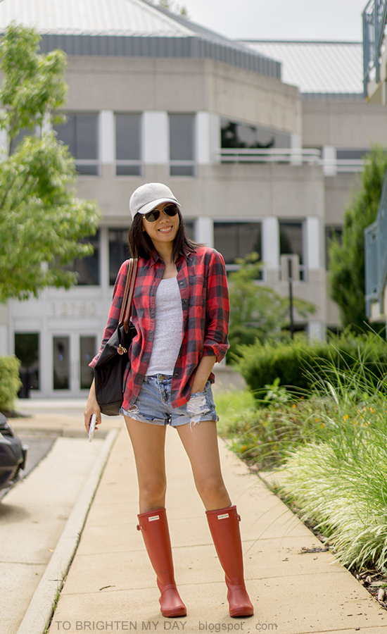 gray baseball cap, buffalo red check shirt, gray tank, distressed shorts, black tote, red rain boots