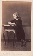 Portrait of a boy reading by Ferdinand Mulnier (1860s)