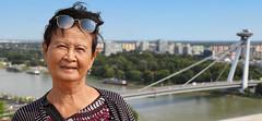 Grandma Bunrod in front of the UFO bridge in Bratislava