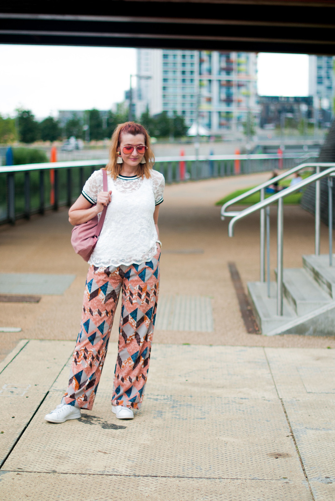 Bold, colourful summer dressing: White lace top pyjama-style patterned trousers pants white Stan Smiths statement tassel earrings orange aviators pink suede backpack | Not Dressed As Lamb, over 40 style blog