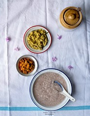 Green Lentils with Broken Kerala Matta Rice Gruel (Congee) served with Cut Green Mango Pickle [Payarum Kanji pinne ithri kadu manga achar]