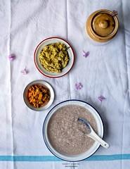 Green Lentils with Broken Kerala Matta Rice Gruel (Congee) served with Cut Green Mango Pickle [Payarum Kanji pinne ithri kadu manga achar]