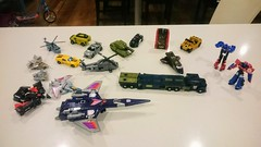 Liam and Isaac and daddy's collection of Transformers figurines