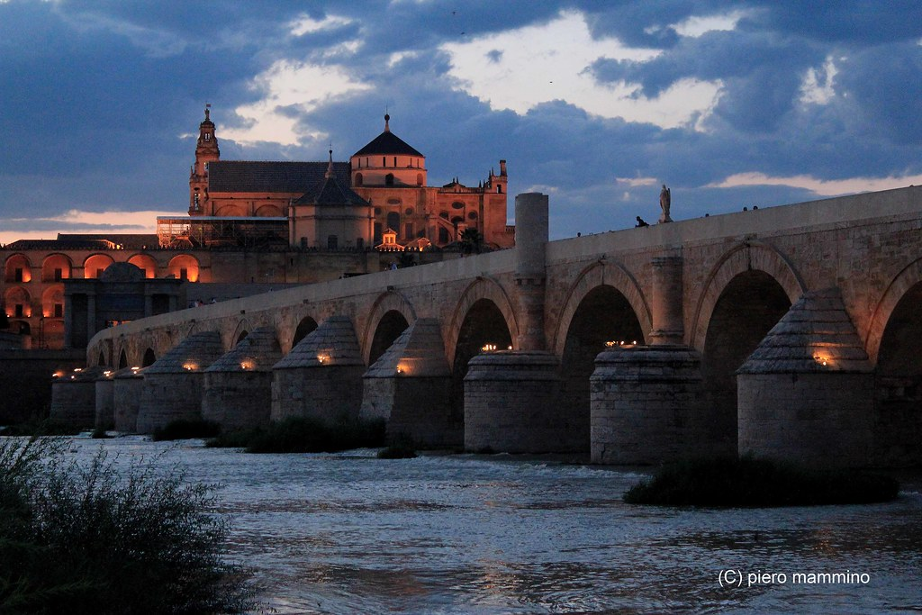 Cordoba _ cloudy night above the Roman Bridge and the Mezquita