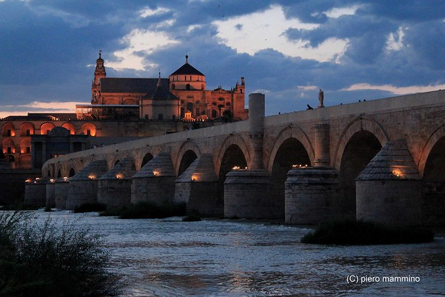 Cordoba _ cloudy night above the Roman Bridge and the Mezquita