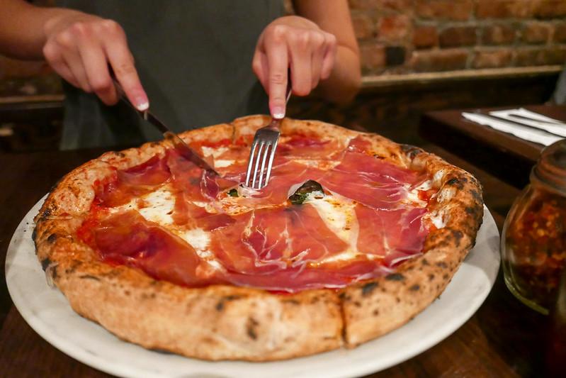 MARGHERITA WITH PROSCUITTO tomato sauce, fresh mozzarella, pecorino romano, basil, extra virgin olive oil ($19)
