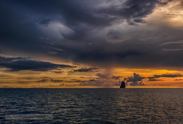 Sunset with rain at Andaman sea