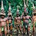 Tribesmen dancing in the jungle with helmet masks for a circumcision ceremony, Malampa Province, Malekula Island, Vanuatu by Eric Lafforgue