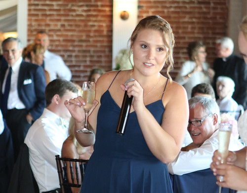 Elizabeth Decker with Mic and a Toast