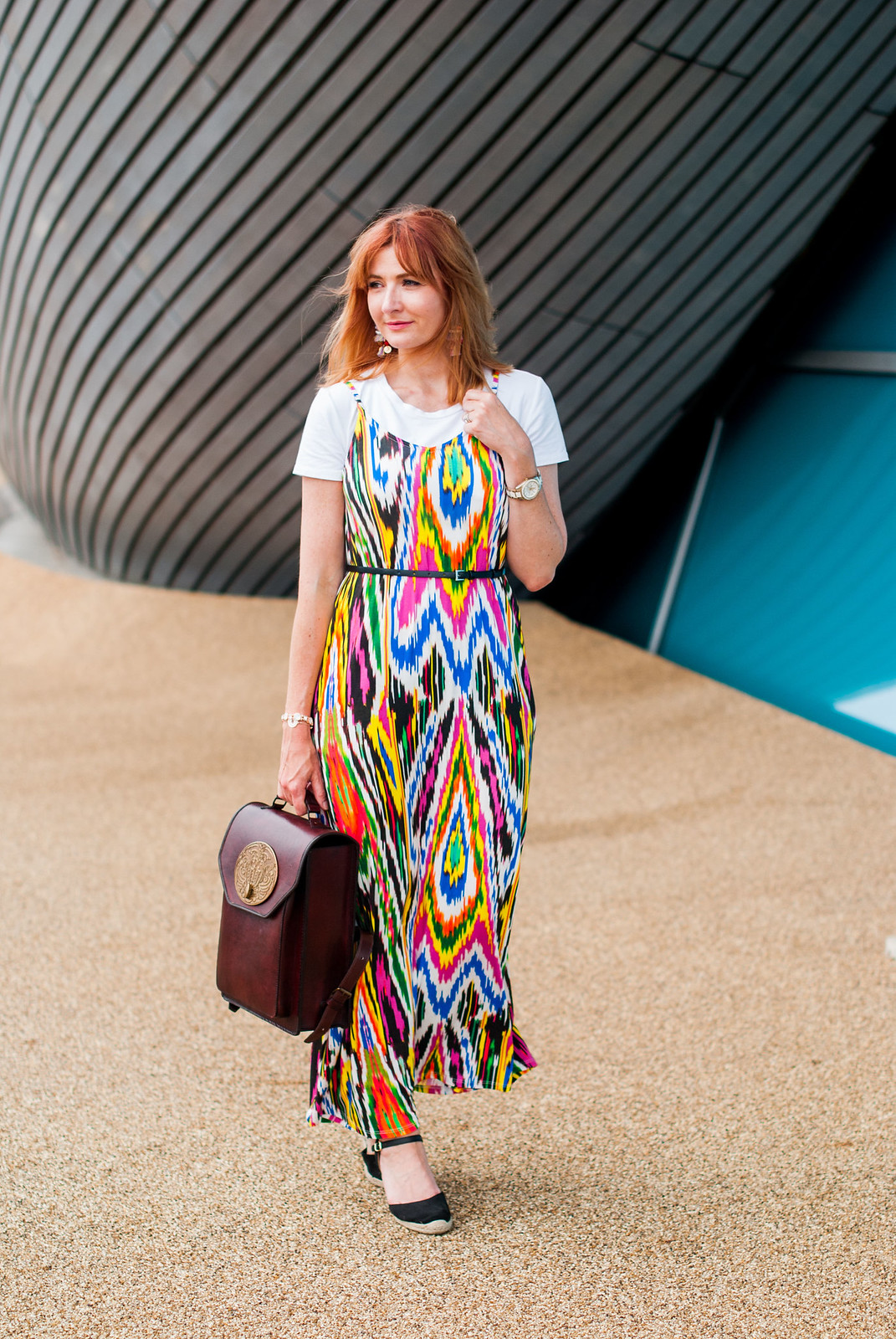 A rainbow-bright summer maxi dress styled in 90s style: Multi-coloured strappy maxi dress  plain white t-shirt tee  black wedge espadrilles  Beara Beara brown leather backpack with antique brass plaque | Not Dressed As Lamb, over 40 style
