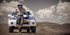 Explorer in safari outfit and four-wheel drive.