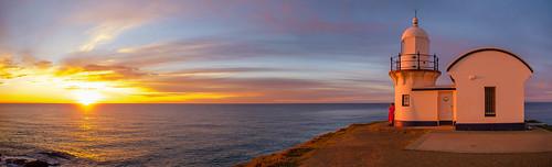 portmacquarie nsw tackingpoint lighthousebeach lighthouse sunrise pacific ocean australia sea morning water colours sun dawn daybreak clouds downunder fujifilm panoramic pano horizon