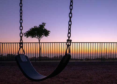 swing set sunset sky purple orange five canyons park castro valley power lines gate