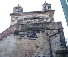Photo of Newcastle Town Wall black plaque