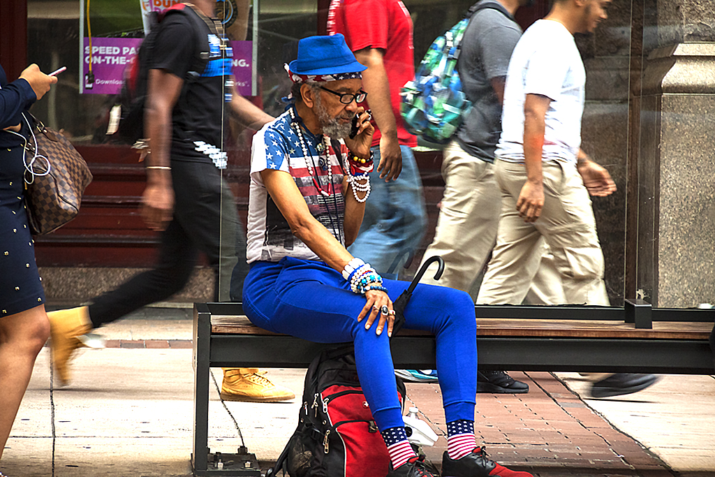 Patriotic gay man at bus stop--Center City