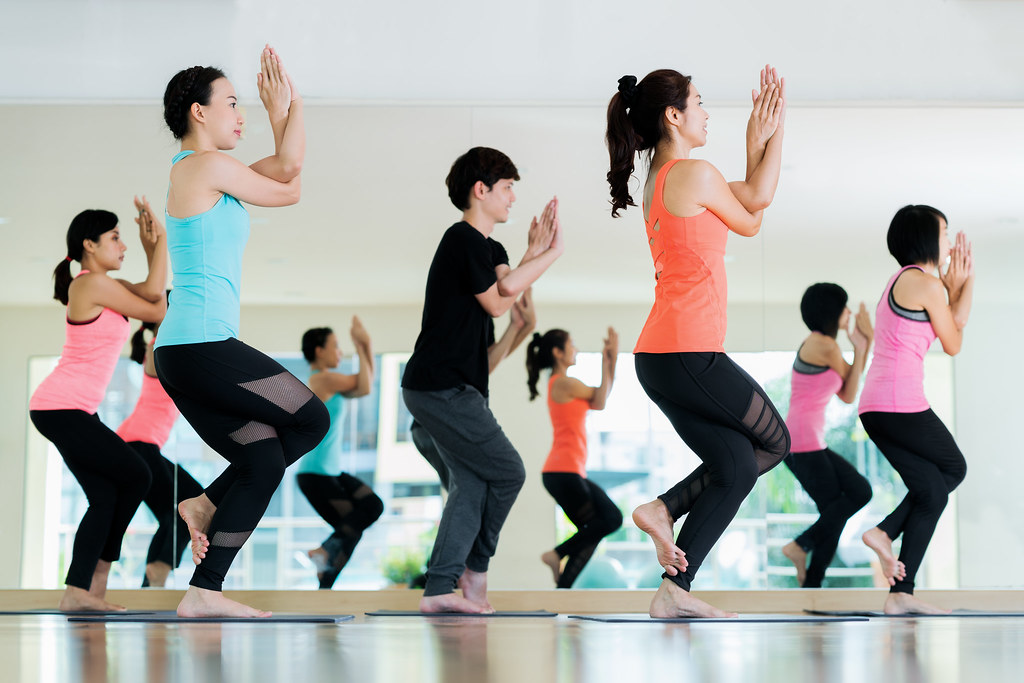 yoga group in class room in fitness center