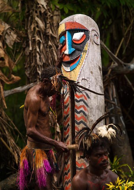 Small Nambas tribesman beating on a slit gong drum during the palm tree dance, Malekula island, Gortiengser, Vanuatu