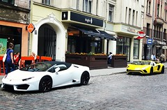 Indian restaurant owner boasting of his cars in central Riga, Latvia. July 26, 2017