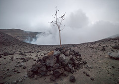 Grave in front of an eruption at the top of mt Yasur volcano, Tanna island, Mount Yasur, Vanuatu