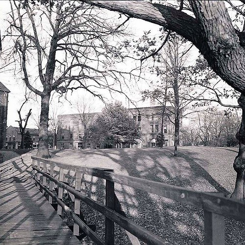 Check out this beautiful shot of old campus from the student bridge! We're glad the bridge is still a fixture on campus today! #TBT