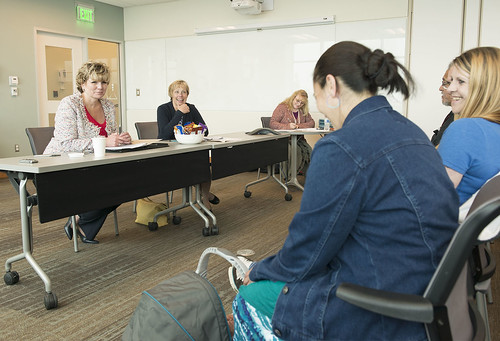 Chief Judge Kimberley Sweet, Kenaitze Tribal Court,  and Judge Anna Moran, Kenai Superior Court, offer encouragement to participants enrolled in the Henu' Community Wellness Court during a court session held after the court's grand opening in June. Henu'