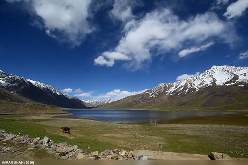 clouds elements ghizer gilgitbaltistan greenery ice lake landscape location mountains pakistan shandur sky snow vegetation water wide