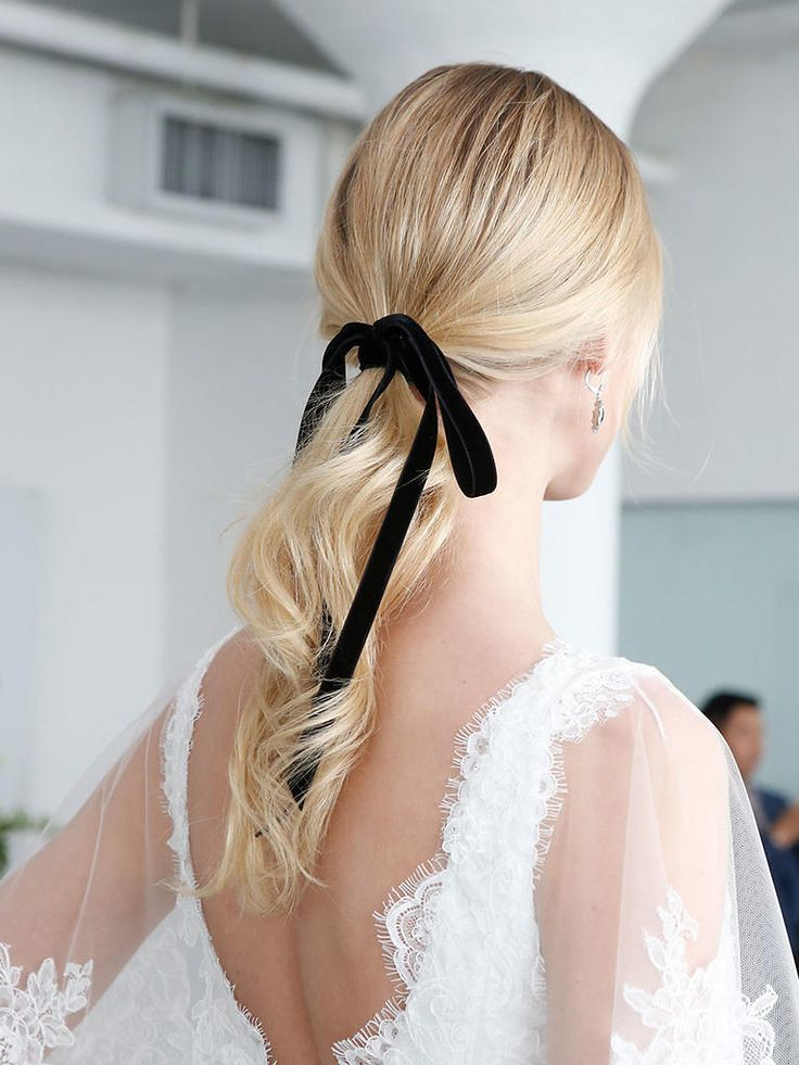 Wedding Hairstyle Ideas : Tie a black vintage ribbon around a low ponytail for a classic wedding hairstyle...