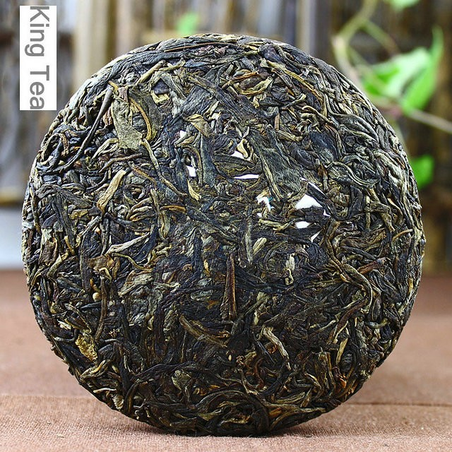 Free Shipping 2013 LaoManEr Deep Mountain Old Arbor Cake 100g China YunNan MengHai Chinese Puer Puerh Raw Tea Sheng Cha