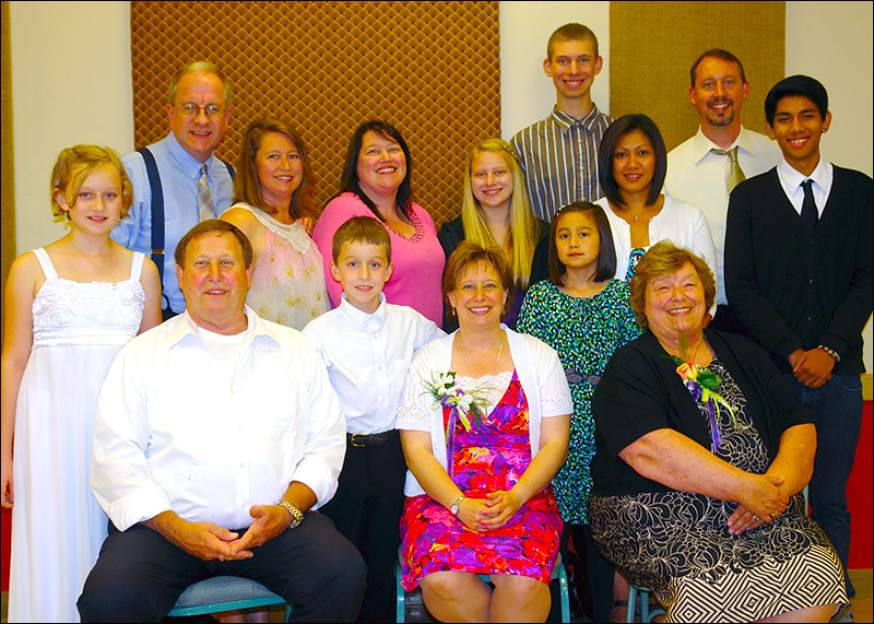 Family members surround Sr. Jessica for a photo at the reception following her profession.