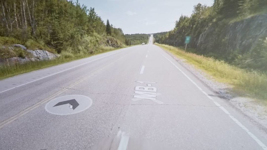 After miles and miles of prairie, I am on a hill. My heart is pounding with excitement! #ridingthroughwalls #xcanadabike #googlestreetview #manitoba