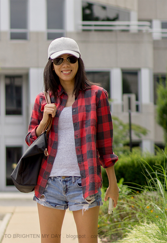 gray baseball cap, buffalo red check shirt, gray tank, distressed shorts, black tote