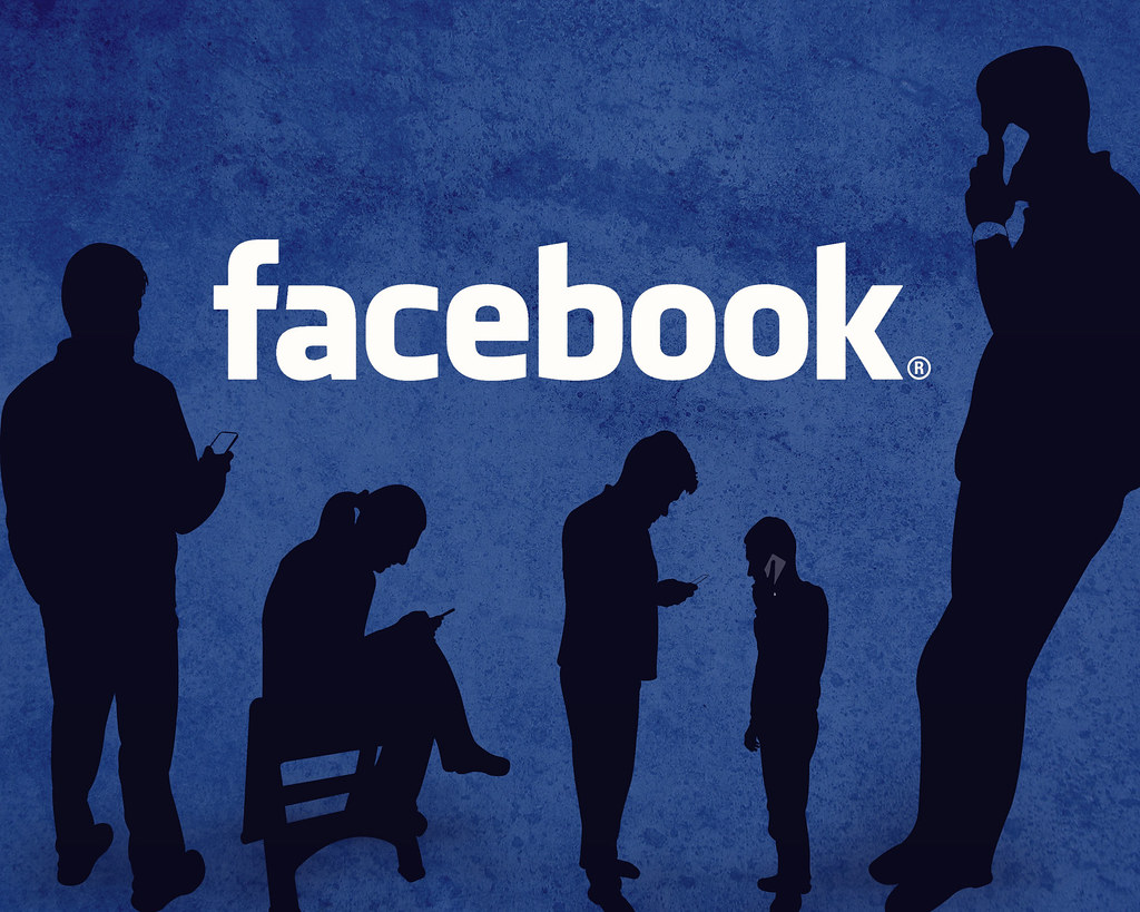 Facebook Logo With Silhouettes Of People