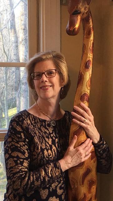 Mary Cook with Giraffe carving Mary@LovingPurpose.com