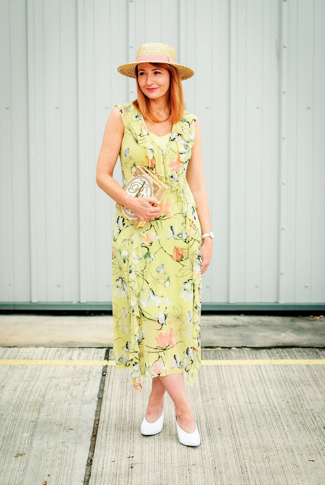 Wedding guest or garden party outfit: Pale green and pink floral midi dress with ruffles  straw boater with pink ribbon  novelty Paris book clutch  white v neck pointed toe mule heels | rose gold jewellery | Not Dressed As Lamb, over 40 style