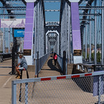 It looks like several shades of purple are being tested out for a repainting of the faded Purple People Bridge.
