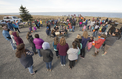 Children, their family members, and staff gather around the Del Dumi Drum during the Early Childhood Center's yearend picnicin May.