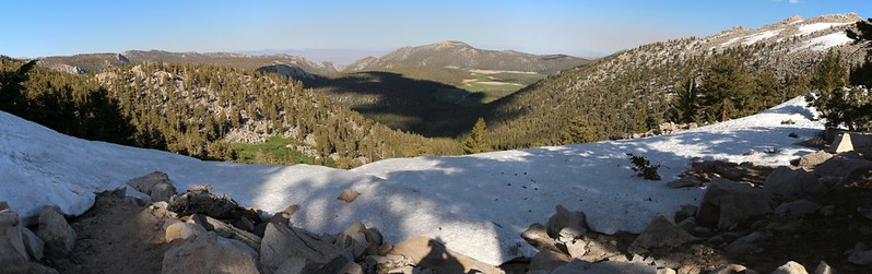 Horseshoe Meadows is far below under cloud-shadows, viewed from the snow berm on Cottonwood Pass