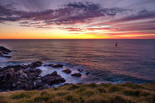 ocean sea pacificocean sailing sailboat sunrise sun australia portmacquarie lighthousebeach tackingpoint morning dawn sky