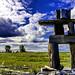 Wooden Inukshuk  & Blue Sky