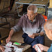 Bamboo boat drivers playing cards