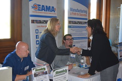 Rep. Dauphinais speaks with employees from EAMA during Manufacturing Day at the Capitol