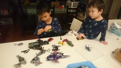Liam and Isaac playing with Transformers before bed