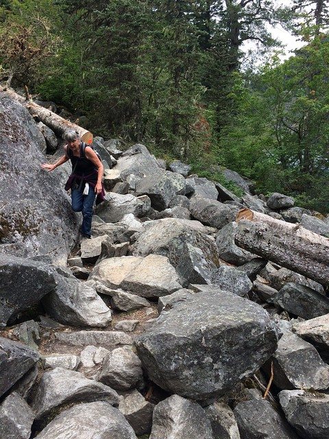 Linda through the rocks at Lindeman lake