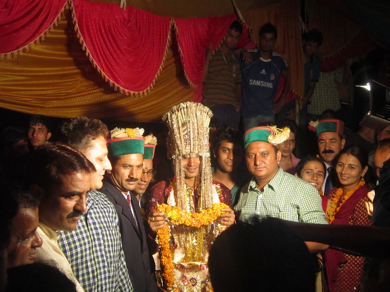 The groom arrives at a village wedding in India