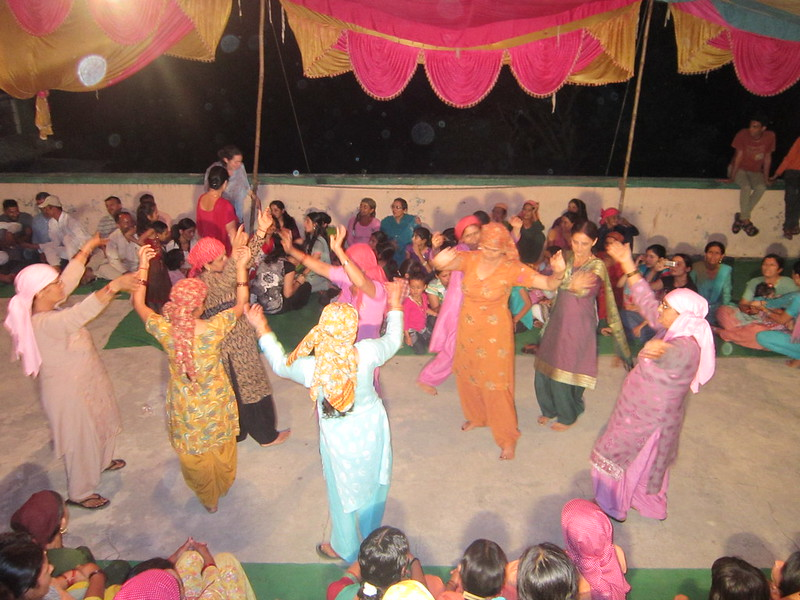 Female dancers at a village wedding in India