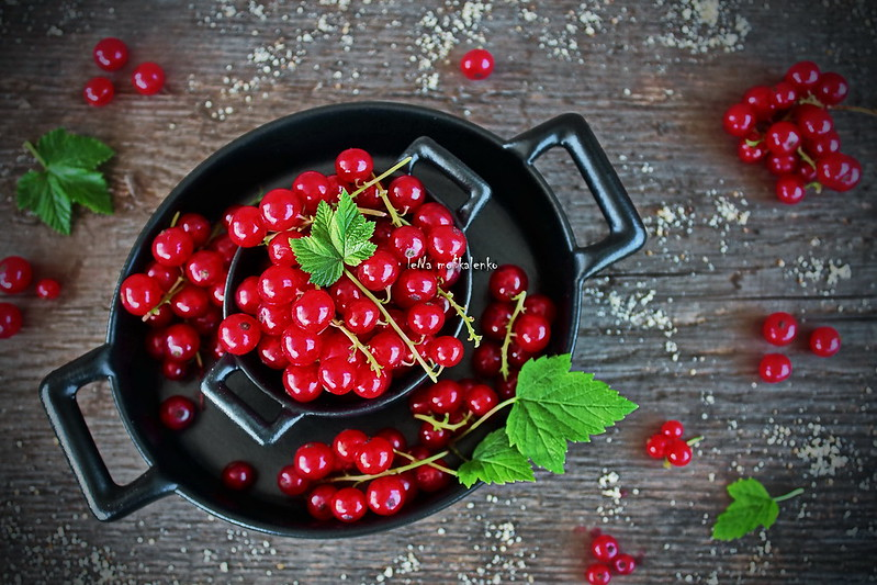 ...red currants in a black dish