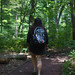 Small photo of Woman walking woods