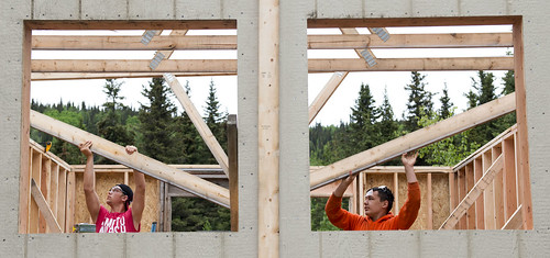 Jarrett Wilson and Gage Moto help install trusses in a cabin they helped build during the Construction Academy camp for youth earlier this summer. The camp was a partnership between the tribe and the Kenai Peninsula Borough School District.
