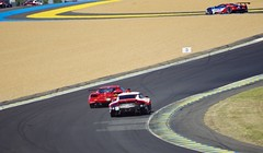 Porsche 911 RSR and a Ferrari 488 GTE chase a Ford GT up the hill